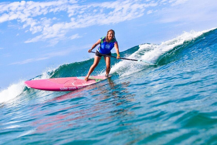 """""""For lifelong surfers SUP (Stand Up Paddleboarding) is a way to get your adrenaline going. It's a whole new challenge and it's really exciting,"""" said Surf Diva instructor Izzy Tihanyi said (pictured)."""