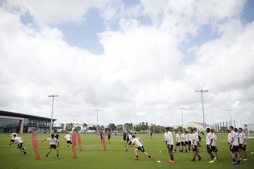 Inter Miami CF players runs through drills during a team practice session in February.