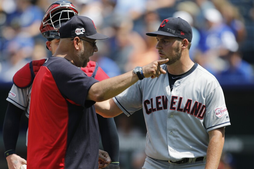 """FILE - In a Sunday, July 28, 2019 file photo, Cleveland Indians manager Terry Francona, left, has words with pitcherTrevor Bauer, right, as Bauer is taken out in the fifth inning of a baseball game against the Kansas City Royals at Kauffman Stadium in Kansas City, Mo. Francona said Sunday, July 5, 2020 that he believes the Indians need to change their name. """"I think it's time to move forward,"""" Francona said Sunday. (AP Photo/Colin E. Braley, File)"""