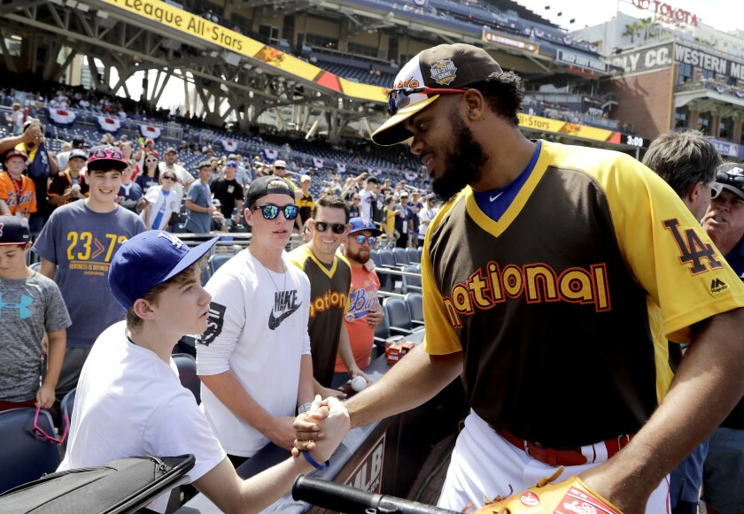 Dodgers closer Kenley Jansen greets a fan before the start of the home run derby Monday at Petco Park in San Diego.