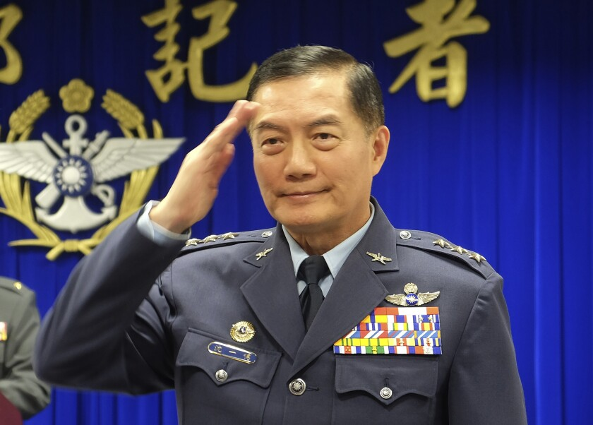 FILE - In this March 7, 2019, file photo, Taiwanese top military official Shen Yi-ming salutes as he is introduced to journalists during a press conference in Taipei, Taiwan. Shen is missing after a helicopter he was on with 12 others was forced to make an emergency landing in a mountainous area in New Taipei City early Thursday morning, the defense ministry said. (AP Photo/Johnson Lai, File)