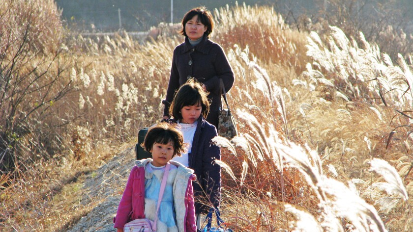 Sisters Bin (Son Hee Kim), and Jin (Hee Yeon Kim) take a trip with Big Auntie; in a scene from TREEL