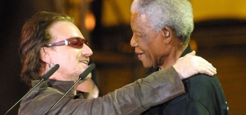 Bono and Nelson Mandela embrace after the leader's release.