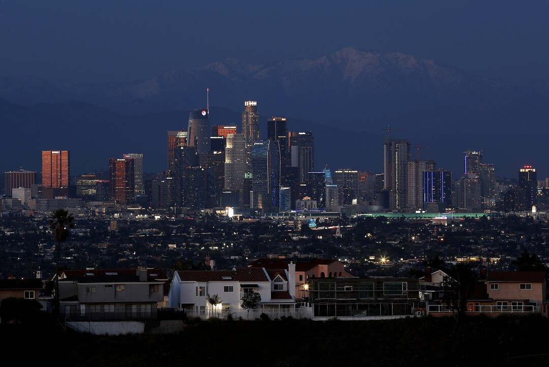Dusk settles on downtown Los Angeles and the snow-capped Mt. Baldy.