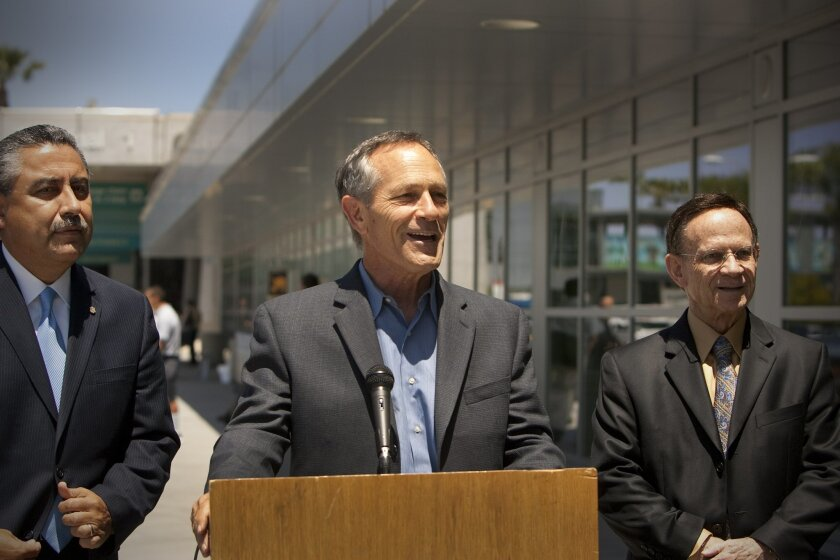 Alan Bersin during a May 2011 news conference at Lindbergh Field with Baja California tourism secretary Juan Tintos, left, and Hugo Torres, former mayor of Rosarito Beach. / Photo by Nelvin C. Cepeda * U-T