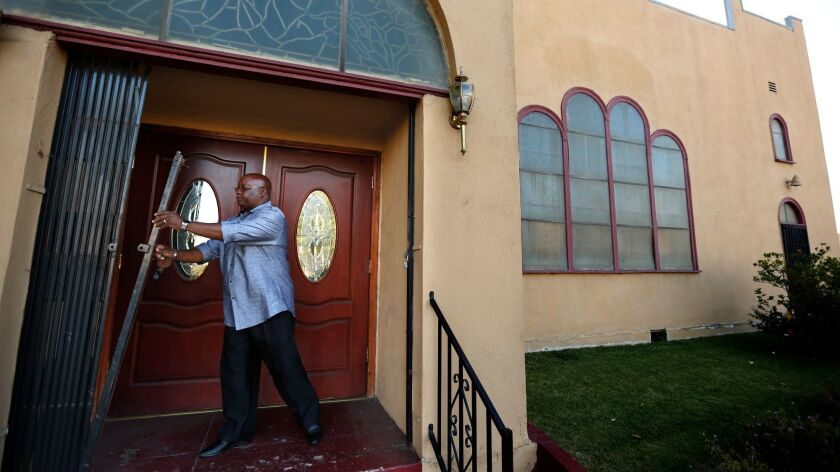 LOS ANGELES, JUNE 15, 2017 -- Pastor Kenneth Little opens the main door to the Ebenezer Baptist Chur
