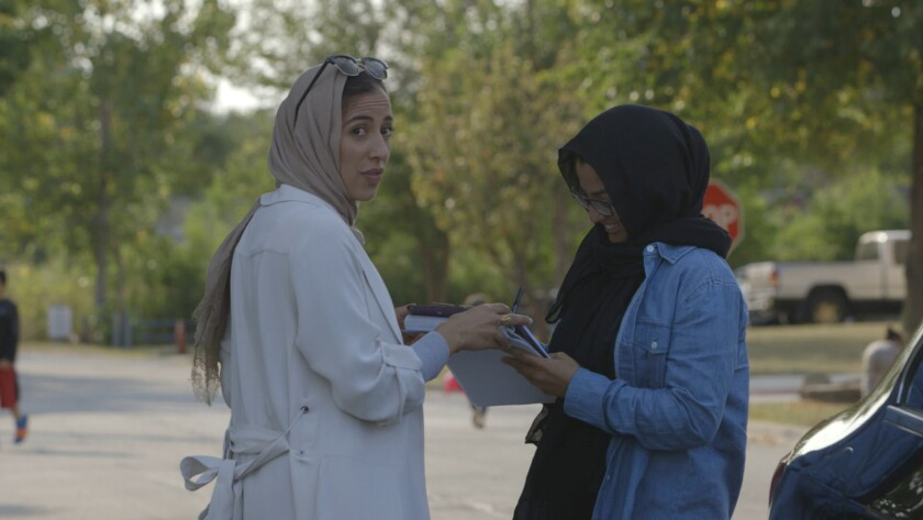 """(L-R)- Iman Boundaoui and Esra Rahima in a scene from """"The Feeling of Being Watched."""" Credit: Watch"""