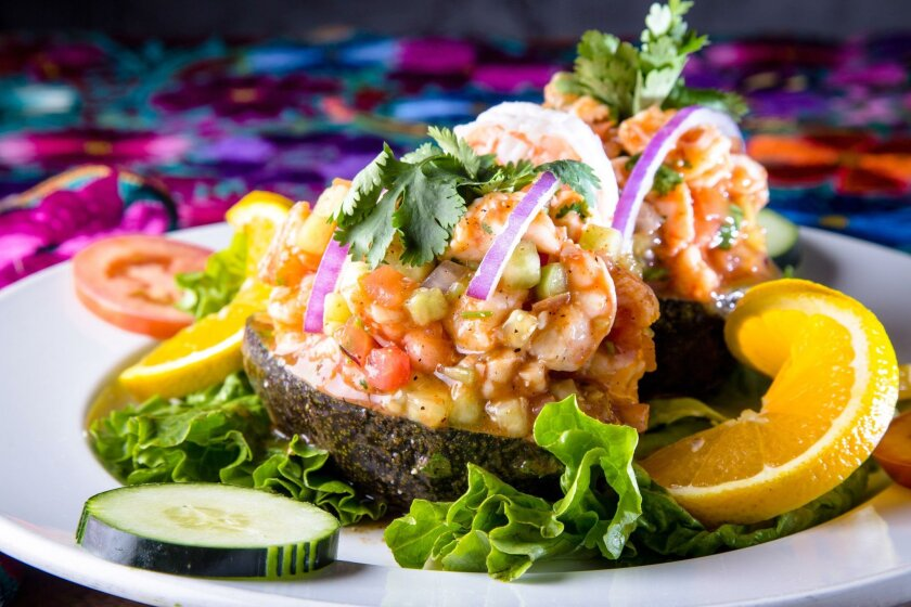 Aguacates rellenos at Karina's Mexican Seafood in Otay Ranch Town Center. Stuffed avocados with cooked shrimp, onions, tomatos, cilantro, cucumber, serrano peppers in a sweet tomato sauce.