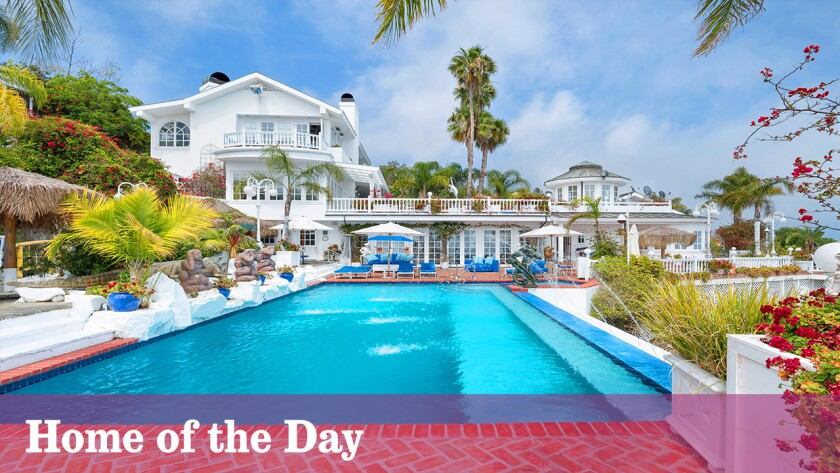 The roughly two-acre compound, listed for $24.495 million, sits behind a gated entrance on a hillside in Malibu.