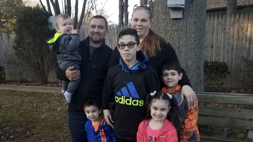 Hector Soriano and his fiancee, Jennifer Carlsen, with, from left Tomas, 10 mos.; Manny, 3; Antonio