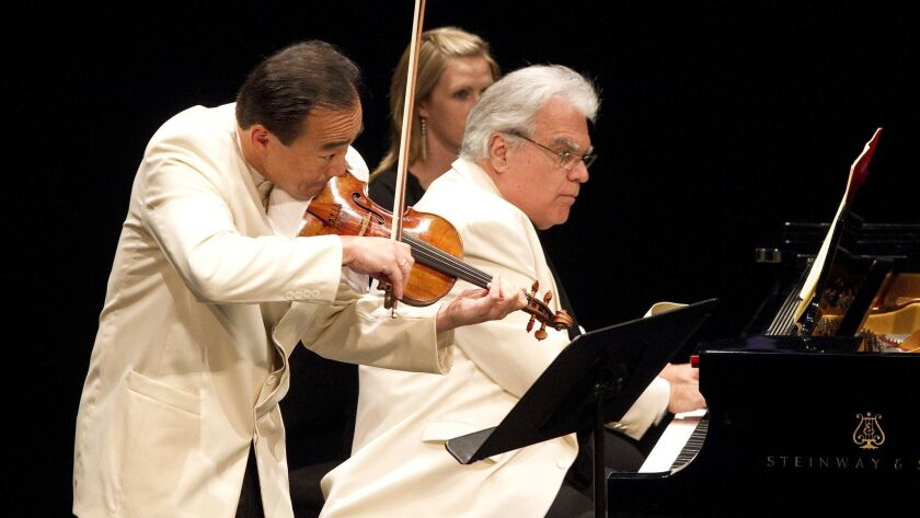 Violinist Cho-Liang Lin (left), SummerFest's music director, and pianist Joseph Kalichstein perform