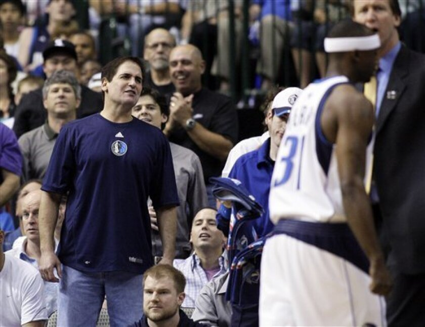 Dallas Mavericks owner Mark Cuban reacts in the first half of Game 4 of the NBA basketball Western Conference semifinal, Monday, May 11, 2009, in Dallas. (AP Photo/Matt Slocum)