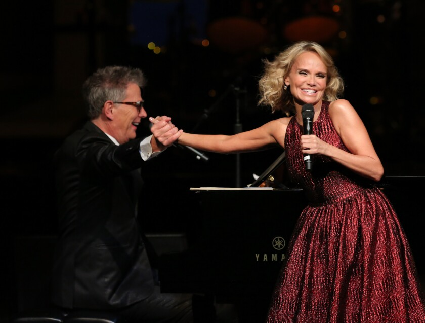 """Host David Foster and singer-actress Kristin Chenoweth perform onstage at """"A PBS SoCal Holiday Celebration."""""""