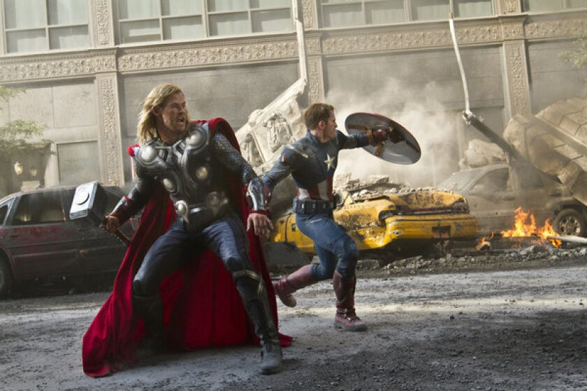 """Chris Hemsworth portrays Thor, left, and Chris Evans portrays Capt. America in a scene from """"The Avengers,"""" one of the hit films of 2012."""