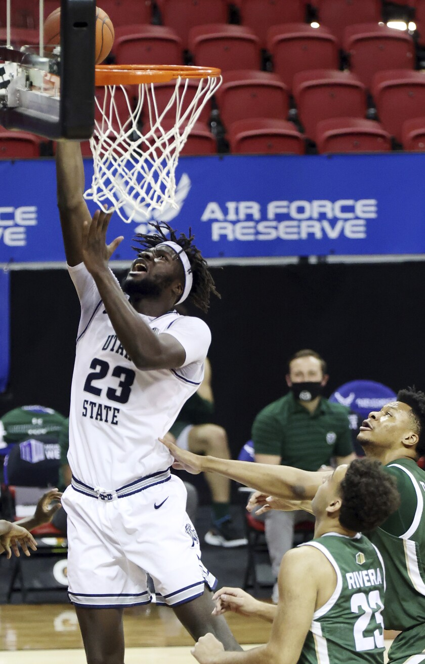 Utah State center Neemias Queta (23) shoots during the first half of the team's NCAA college basketball game against Colorado State in the semifinals of the Mountain West Conference men's tournament Friday, March 12, 2021, in Las Vegas. (AP Photo/Isaac Brekken)