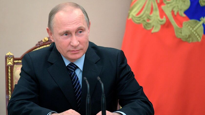 Russian President Vladimir Putin chairs a Security Council meeting in Moscow, Russia, Friday, June 1
