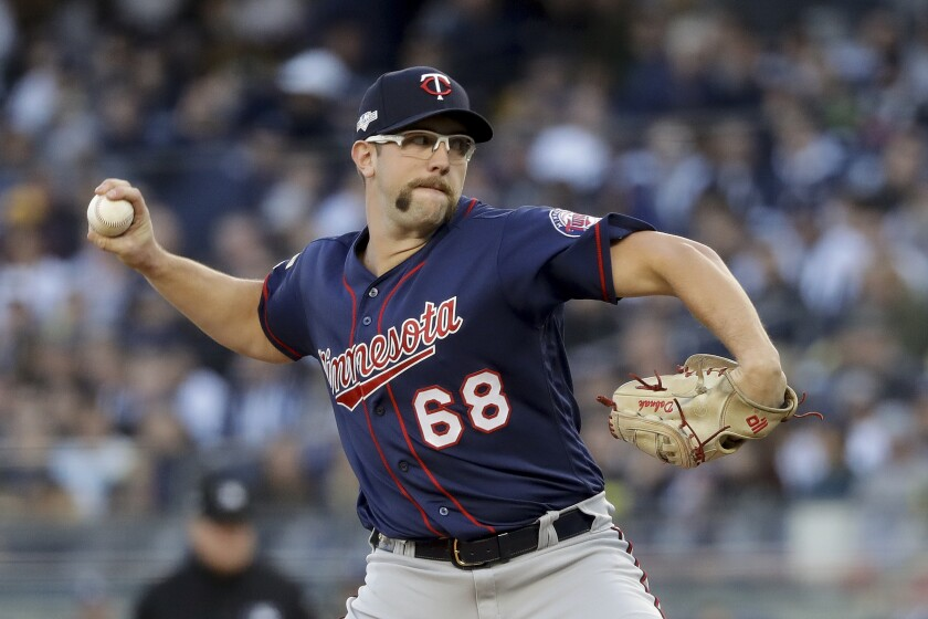 Minnesota Twins starting pitcher Randy Dobnak (68) delivers against the New York Yankees during the first inning of Game 2 of an American League Division Series baseball game, Saturday, Oct. 5, 2019, in New York. (AP Photo/Frank Franklin II)