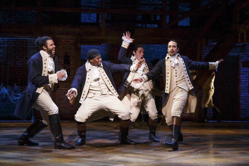 "Actors Daveed Diggs, Okieriete Onaodowan, Anthony Ramos and Lin-Manuel Miranda performing in ""Hamilton."""