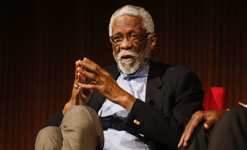 NBA legend Bill Russell speaks at an event.