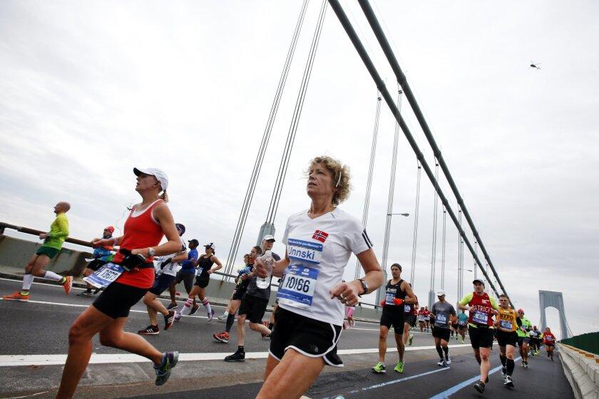 Runners cross the Verrazano-Narrows Bridge at the start of the New York City Marathon, Sunday, Nov. 1, 2015, in New York. (AP Photo/Jason DeCrow)