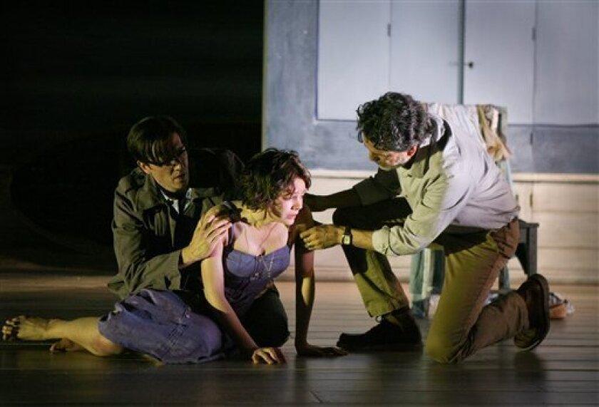 """In this theater publicity image released by Boneau/Bryan-Brown, from left, Jason Butler Harner, Carey Mulligan, and Chris Sarandon are shown in a scene from """"Through a Glass Darkly."""" (AP Photo/Boneau/Bryan-Brown, Ari Mintz)"""