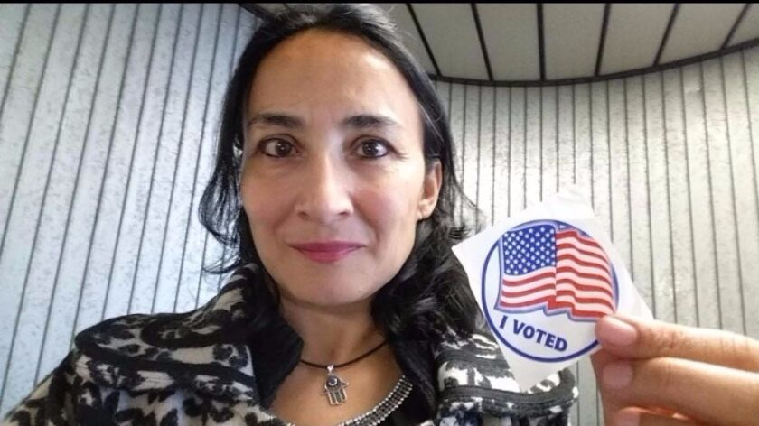 """Asra Nomani poses after casting her ballot. """"I, a 51-year-old, a Muslim, an immigrant woman """"of color, """" am one of those silent voters for Donald Trump."""""""
