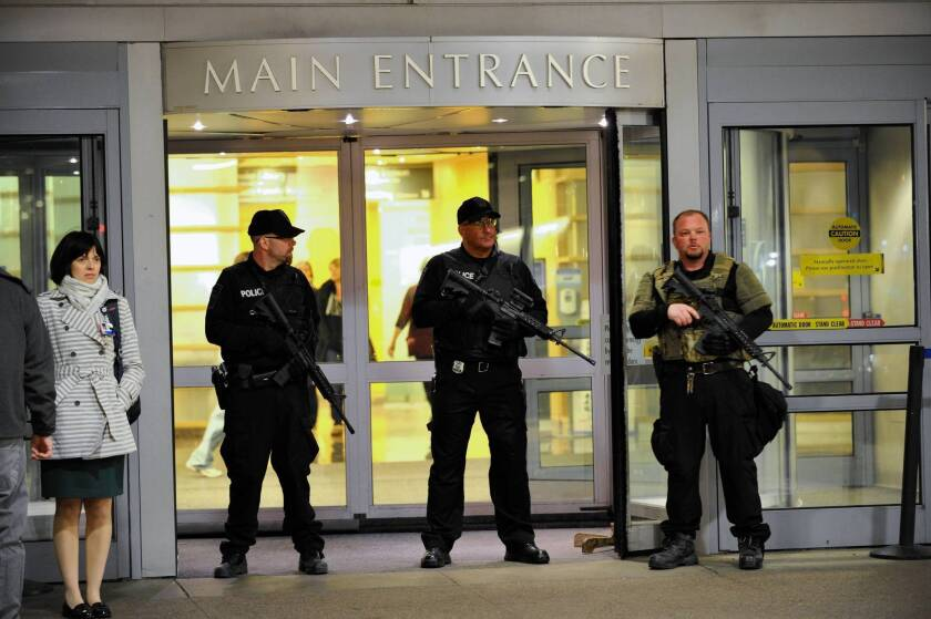 Police guard Brigham and Women's Hospital in Boston, one of the high-level trauma centers treating those injured in the marathon bombings.