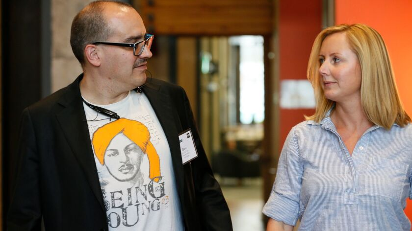 Dave McClure, left, founder of business incubator 500 Startups, is going through counseling after inappropriate conduct around women, according to his firm. Above, McClure with Claire Lee of Silicon Valley Bank in 2015.