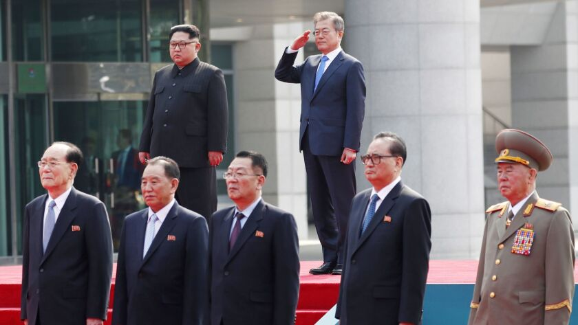 North Korean leader Kim Jong Un, top left, and South Korean President Moon Jae-in, top right, inspect an honor guard following their summit in Panmunjom on April 27.