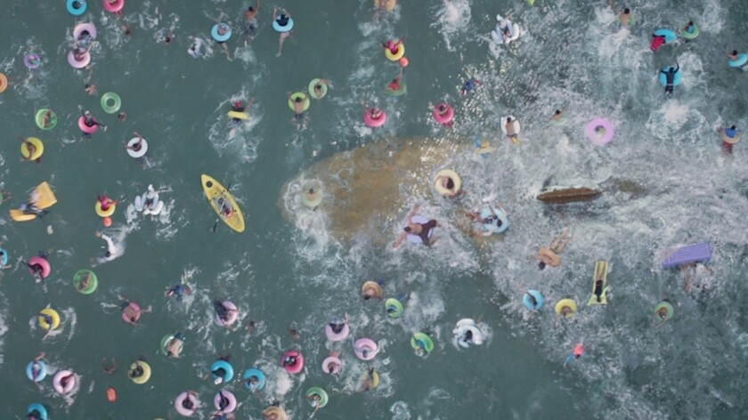 """A prehistoric giant shark threatens a crowded Chinese beach in a scene from """"The Meg."""""""