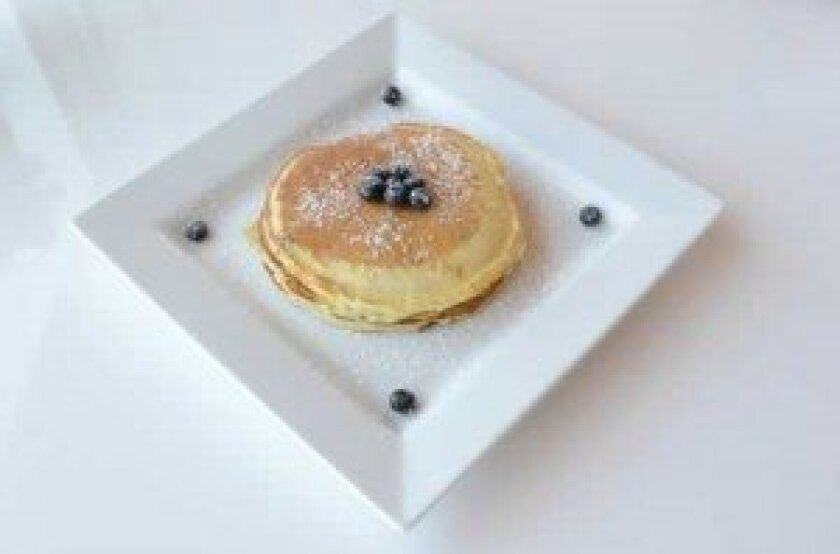 Housemade Buttermilk Pancakes with blueberries.
