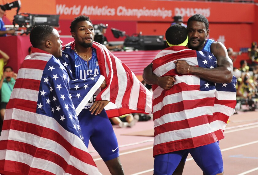 The U.S. men's team celebrates after winning the 400-meter relay on Saturday.