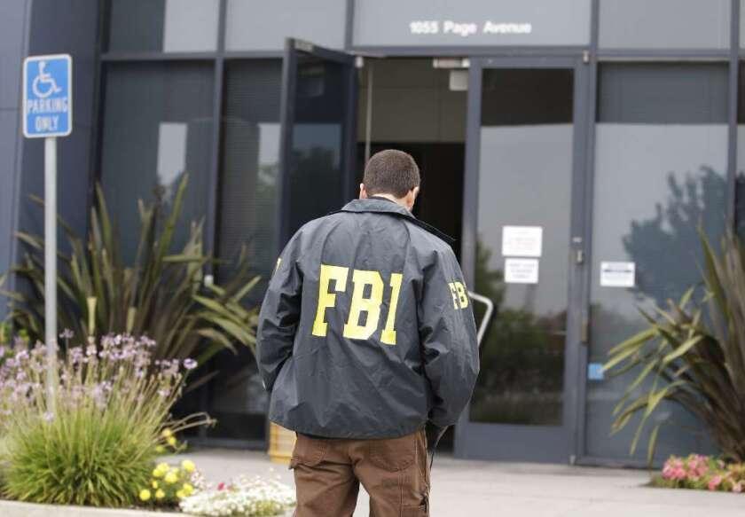 FBI agents arrested two people in an alleged $110-million Orange County Ponzi scheme.