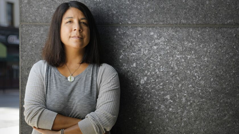 """""""I think I do tend to gravitate to stories about people who are outsiders, or who are trying to figure something out about their identity and the world around them,"""" says Naomi Iizuka, who was born to a Japanese father and a mother of Cuban and Spanish heritage."""