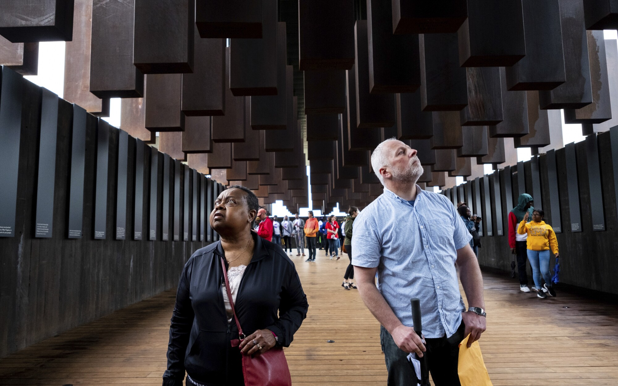 Virginia Huston and Warren Read gaze up inside the National Memorial for Peace and Justice in Montgomery, Ala., in 2018.