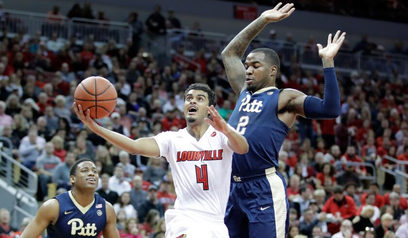 Louisville's Quentin Snider (4) shoots the ball during the game against Pittsburgh on Wednesday.