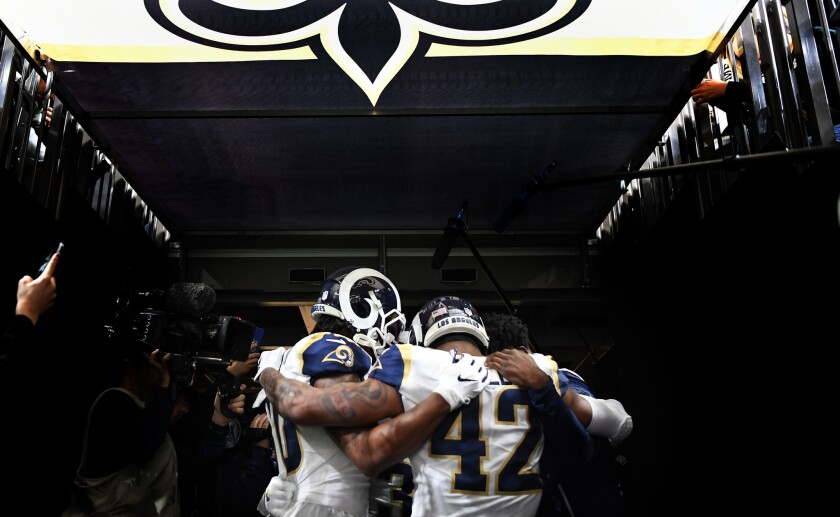 The Rams running backs huddle before a game between the Rams and Saints in the NFC Championship in New Orleans on Jan. 20.
