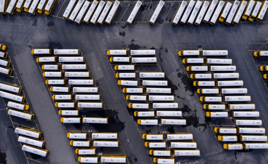 LAUSD buses sit idle in a district transportation yard in Gardena