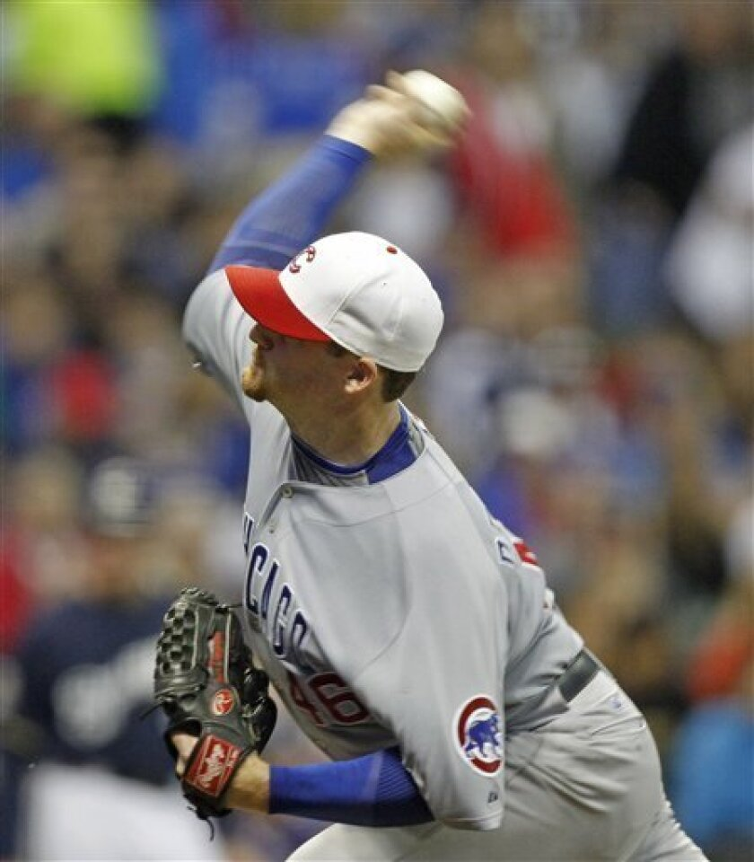Chicago Cubs starting pitcher Ryan Dempster delivers to the Milwaukee Brewers in the seventh inning of a baseball game Saturday, Sept. 11, 2010, in Milwaukee. (AP Photo/Jeffrey Phelps)