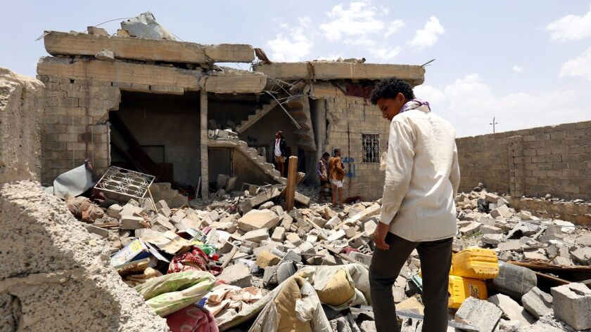 Yemenis inspect a two-story building after it was hit Aug. 23, 2017, presumably in Saudi-led airstrikes, on the northern outskirts of Sana.