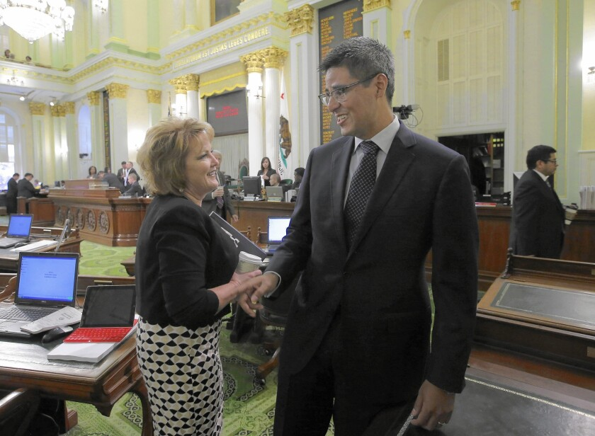Assemblywoman Shannon Grove (R-Bakersfield) talks during the summer with Assemblyman Henry T. Perea (D-Fresno), who leads the moderate Democrats.