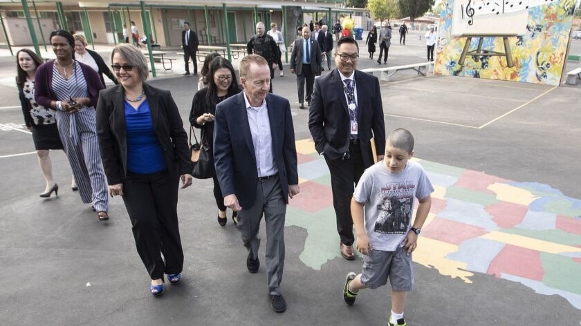 Recently hired L.A. schools Supt. Austin Beutner, center, is seeking to bring in new funding from local foundations.