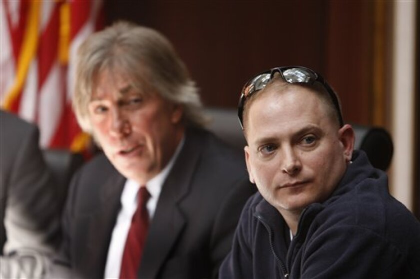 """Attorney Geoffrey Fieger, left, and Master Sgt. Jeffrey Sarver are seen during a news conference in Southfield, Mich., Wednesday, March 3, 2010. Sarver, a bomb disposal expert who served in the Iraq war has filed a lawsuit against the makers of """"The Hurt Locker"""" alleging they falsely claim the characters in the Oscar-nominated film are fictional. The multimillion-dollar lawsuit is being filed by Fieger on behalf of Sarver of Clarksville, Tenn. Fieger and Sarver claim the film's screenwriter Mark Boal was embedded in Sarver's unit, and the information he gathered was used in the film. (AP Photo/Carlos Osorio)"""