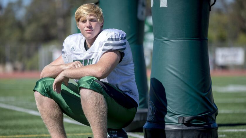 In addition to starting on the offensive and defensive lines, Poway's Andrew Johnson was a section wrestling champion last season.