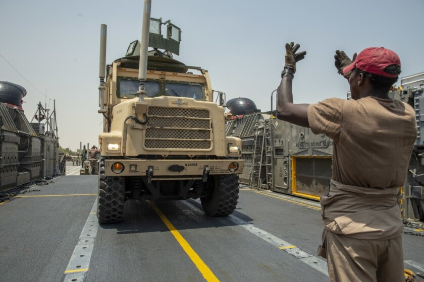 Marines with Combat Logistics Battalion 11, 11th Marine Expeditionary Unit (MEU) drive a 7-ton truck onto a landing craft, air cushion at Kuwait Naval Base in August. A Camp Pendleton-based Marine was killed in a similar vehicle in an accident in United Arab Emirates on Tuesday.