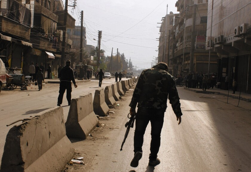 A rebel fighter in Aleppo, Syria. Qatar is a leading financial supporter of the Syrian opposition.