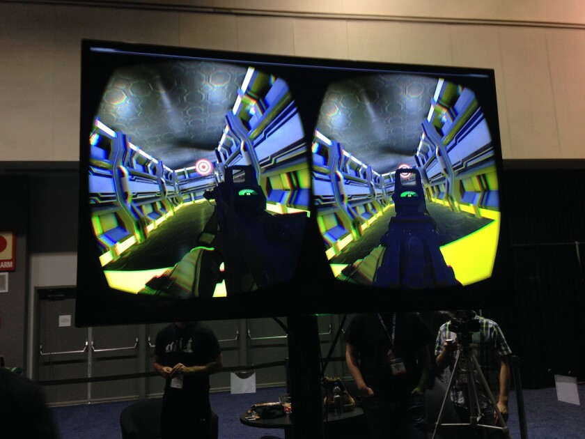 A screen shows the video playing inside the goggles of an Omni user, from the company Virtuix, on display at the Electronic Entertainment Expo.