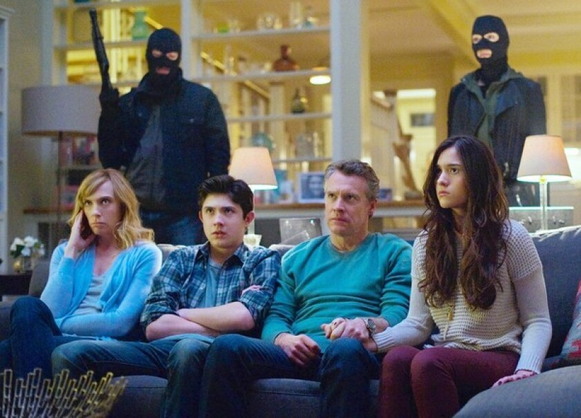 """Toni Collette, left, stars with Tate Donovan, second from right, Quinn Shephard, right, and Mateus Ward in """"Hostages."""""""