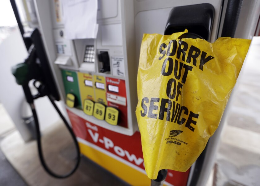 """A """"out of service"""" bag covers a pump handle at a Nashville gas station that has no fuel to sell on Sept. 17."""