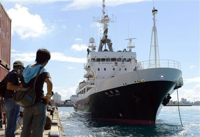 A survey ship dispatched from the Tokyo metropolitan government arrives at a port in Ishigaki, Okinawa Prefecture, Japan, Saturday, Sept. 1, 2012. Tokyo city officials intending to buy tiny islands at the center of a longtime territorial dispute with China will travel by the boat to survey the area